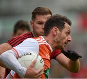 19 May 2019; Jamie Clarke of Armagh in action against Gerard Collins of Down during the GAA Football Senior Championship quarter-final match between Down and Armagh at Pairc Esler in Newry. Photo by Philip Fitzpatrick/Sportsfile
