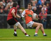 19 May 2019; Jamie Clarke of Armagh in action against Ryan McAleenan  of Down during the GAA Football Senior Championship quarter-final match between Down and Armagh at Pairc Esler in Newry. Photo by Philip Fitzpatrick/Sportsfile