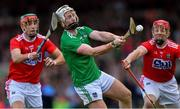 19 May 2019; Cian Lynch of Limerick in action against Stephen McDonnell, left, and Bill Cooper of Cork during the Munster GAA Hurling Senior Championship Round 2 match between Limerick and Cork at the LIT Gaelic Grounds in Limerick. Photo by Piaras Ó Mídheach/Sportsfile