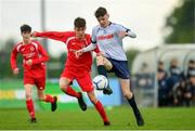 19 May 2019; Joey Reynolds of DDSL in action against Cormaic Kelly of Cork during the Under 16 SFAI Subway Championship Final match between DDSL and Cork at Mullingar Athletic in Gainstown, Westmeath. Photo by Ramsey Cardy/Sportsfile