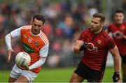19 May 2019; Jamie Clarke of Armagh in action against Gerard Collins of Down during the GAA Football Senior Championship quarter-final match between Down and Armagh at Páirc Esler in Newry. Photo by Philip Fitzpatrick/Sportsfile