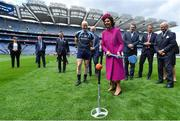 22 May 2019; Queen Silvia makes an attempt to hit a sliothar with a hurley watched by King Carl XVI Gustaf of Sweden, Uachtaráin Cumann Lúthchleas Gael John Horan and Charlie Harrison, GAA National Cúl Camp Co-ordinator, during a visit to Croke Park GAA Stadium in Dublin. Photo by Brendan Moran/Sportsfile