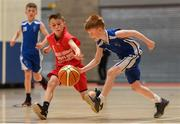 25 May 2019; Ryan Holland from Oranmore, Co. Galway in action against Jamie Nolan from Castleisland, Co. Kerry, in the Basketball Under 11 and Over 9 Mixed event during Day 1 of the Aldi Community Games May Festival, which saw over 3,500 children take part in a fun-filled weekend at the University of Limerick. Photo by Harry Murphy/Sportsfile