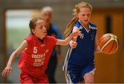 25 May 2019; Cara Cormican from Oranmore, Co. Galway in action against Sophie Horgan from Castleisland, Co. Kerry, in the Basketball Under 11 and Over 9 Mixed event during Day 1 of the Aldi Community Games May Festival, which saw over 3,500 children take part in a fun-filled weekend at the University of Limerick. Photo by Harry Murphy/Sportsfile