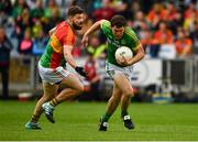 25 May 2019; Pádraic Harnan of Meath in action against Daniel St Ledger of Carlow during the Leinster GAA Football Senior Championship Quarter-Final match between Carlow and Meath at O'Moore Park in Portlaoise, Laois. Photo by Ray McManus/Sportsfile