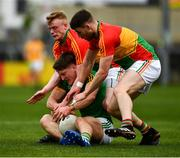 25 May 2019; Thomas O'Reilly of Meath in action against Ciarán Moran, left, and Conor Doyle of Carlow during the Leinster GAA Football Senior Championship Quarter-Final match between Carlow and Meath at O'Moore Park in Portlaoise, Laois. Photo by Ray McManus/Sportsfile