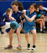25 May 2019; Kate Butler of Maree Basketball Club, Co Galway, left, in action against Mia Murtagh of Donaghmoyne, Co Monaghan, competing in the U11 mixed basketball event during Day 1 of the Aldi Community Games May Festival, which saw over 3,500 children take part in a fun-filled weekend at University of Limerick. Photo by Piaras Ó Mídheach/Sportsfile