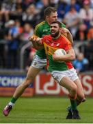 25 May 2019; Seán Murphy of Carlow is tackled by Conor McGill of Meath during the Leinster GAA Football Senior Championship Quarter-Final match between Carlow and Meath at O'Moore Park in Portlaoise, Laois. Photo by Eóin Noonan/Sportsfile