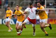 25 May 2019; Matthew Donnelly of Tyrone in action against Odhran Eastwood and Patrick Gallagher of Antrim during the Ulster GAA Football Senior Championship Quarter-Final match between Antrim and Tyrone at the Athletic Grounds in Armagh. Photo by Oliver McVeigh/Sportsfile