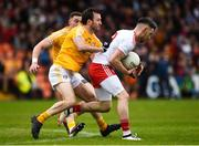 25 May 2019; Matthew Donnelly of Tyrone in action against Patrick Gallagher of Antrim during the Ulster GAA Football Senior Championship Quarter-Final match between Antrim and Tyrone at the Athletic Grounds in Armagh. Photo by Oliver McVeigh/Sportsfile