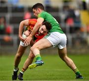 25 May 2019; Diarmuid Walshe of Carlow in action against Donal Keogan of Meath during the Leinster GAA Football Senior Championship Quarter-Final match between Carlow and Meath at O'Moore Park in Portlaoise, Laois. Photo by Ray McManus/Sportsfile