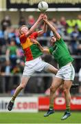25 May 2019; Conor Doyle of Carlow in action against Donal Keogan of Meath during the Leinster GAA Football Senior Championship Quarter-Final match between Carlow and Meath at O'Moore Park in Portlaoise, Laois. Photo by Eóin Noonan/Sportsfile