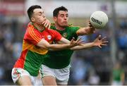25 May 2019; Donal Keogan of Meath in action against Darren Lunney of Carlow during the Leinster GAA Football Senior Championship Quarter-Final match between Carlow and Meath at O'Moore Park in Portlaoise, Laois. Photo by Eóin Noonan/Sportsfile