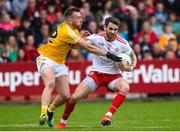 25 May 2019; Ronan McNamee of Tyrone in action against Kevin Quinn of Antrim during the Ulster GAA Football Senior Championship Quarter-Final match between Antrim and Tyrone at the Athletic Grounds in Armagh. Photo by Oliver McVeigh/Sportsfile