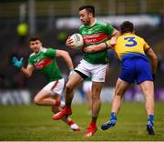 25 May 2019; Kevin McLoughlin of Mayo in action against Sean Mullooly of Roscommon during the Connacht GAA Football Senior Championship Semi-Final match between Mayo and Roscommon at Elverys MacHale Park in Castlebar, Mayo. Photo by Stephen McCarthy/Sportsfile
