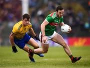 25 May 2019; Darren Coen of Mayo in action against Sean Mullooly of Roscommon during the Connacht GAA Football Senior Championship Semi-Final match between Mayo and Roscommon at Elverys MacHale Park in Castlebar, Mayo. Photo by Stephen McCarthy/Sportsfile