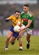 25 May 2019; Evan Regan of Mayo in action against Niall Kilroy of Roscommon during the Connacht GAA Football Senior Championship Semi-Final match between Mayo and Roscommon at Elverys MacHale Park in Castlebar, Mayo. Photo by Stephen McCarthy/Sportsfile