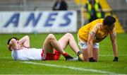 25 May 2019; Conall McCann of Tyrone and Niall Delargy of Antrim after the final whistle in the Ulster GAA Football Senior Championship Quarter-Final match between Antrim and Tyrone at the Athletic Grounds in Armagh. Photo by Oliver McVeigh/Sportsfile