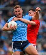 25 May 2019; Ciarán Kilkenny of Dublin is tackled by Ciarán Downey of Louth during the Leinster GAA Football Senior Championship Quarter-Final match between Louth and Dublin at O'Moore Park in Portlaoise, Laois. Photo by Eóin Noonan/Sportsfile