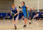 25 May 2019; Ryan Holland of Maree Basketball Club, Co Galway, in action against Mia Murtagh Donaghmoyne, Co Monaghan, competing in the U11 mixed basketball event during Day 1 of the Aldi Community Games May Festival, which saw over 3,500 children take part in a fun-filled weekend at University of Limerick. Photo by Piaras Ó Mídheach/Sportsfile