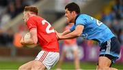 25 May 2019; Ryan Burns of Louth is tackled by Rory O'Carroll of Dublin during the Leinster GAA Football Senior Championship Quarter-Final match between Louth and Dublin at O'Moore Park in Portlaoise, Laois. Photo by Ray McManus/Sportsfile