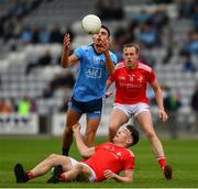 25 May 2019; Niall Scully of Dublin in action against Fergal Donohoe and Jim McEneaney of Louth during the Leinster GAA Football Senior Championship Quarter-Final match between Louth and Dublin at O'Moore Park in Portlaoise, Laois. Photo by Ray McManus/Sportsfile