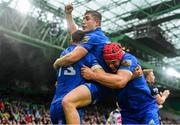 25 May 2019; Garry Ringrose, 13, celebrates with team-mates Jordan Larmour and Josh van der Flier after scoring his side's first try during the Guinness PRO14 Final match between Leinster and Glasgow Warriors at Celtic Park in Glasgow, Scotland. Photo by Ramsey Cardy/Sportsfile