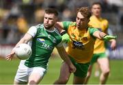 26 May 2019; Daniel Teague of Fermanagh in action against Stephen McMenamin of Donegal during the Ulster GAA Football Senior Championship Quarter-Final match between Fermanagh and Donegal at Brewster Park in Enniskillen, Fermanagh. Photo by Oliver McVeigh/Sportsfile