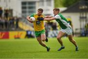 26 May 2019; Daire O'Baoill of Donegal in action against Ultan Kelm of Fermanagh during the Ulster GAA Football Senior Championship Quarter-Final match between Fermanagh and Donegal at Brewster Park in Enniskillen, Fermanagh. Photo by Philip Fitzpatrick/Sportsfile