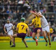 26 May 2019; Lee Chin of Wexford in action against Gearoid McInerney of Galway during the Leinster GAA Hurling Senior Championship Round 3A match between Galway and Wexford at Pearse Stadium in Galway. Photo by Stephen McCarthy/Sportsfile