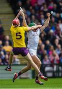 26 May 2019; Niall Burke of Galway in action against Paudie Foley of Wexford during the Leinster GAA Hurling Senior Championship Round 3A match between Galway and Wexford at Pearse Stadium in Galway. Photo by Stephen McCarthy/Sportsfile