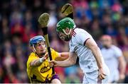 26 May 2019; David Burke of Galway in action against Kevin Foley of Wexford during the Leinster GAA Hurling Senior Championship Round 3A match between Galway and Wexford at Pearse Stadium in Galway. Photo by Stephen McCarthy/Sportsfile