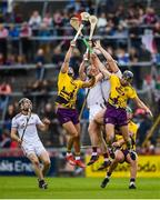 26 May 2019; Lee Chin, left, and Liam Og McGovern of Wexford in action against Aidan Harte, left, and Joseph Cooney of Galway during the Leinster GAA Hurling Senior Championship Round 3A match between Galway and Wexford at Pearse Stadium in Galway. Photo by Stephen McCarthy/Sportsfile