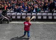 26 May 2019; Two-year-old Tommy Joyce, from Loughrea, Galway, takes in the applause from the crowd prior to the Leinster GAA Hurling Senior Championship Round 3A match between Galway and Wexford at Pearse Stadium in Galway. Photo by Stephen McCarthy/Sportsfile