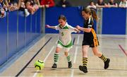 26 May 2019; Faye Gibney of Killoe, Co Longford, left, in action against Abbie Horgan of  Boherlahan Dualla, Co Tipperary, in the indoor soccer U10 Girls final during Day 2 of the Aldi Community Games May Festival, which saw over 3,500 children take part in a fun-filled weekend at University of Limerick. Photo by Piaras Ó Mídheach/Sportsfile