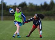 27 May 2019; Cliona Callaghan of Claremorris, Co Mayo, left, in action against Saoirse Eduway, of St Mary's, Co Mayo, during a ladies football blitz at the John West Féile na Peil Regional Launch at Connacht Centre of Excellence, Co. Mayo. Photo by Piaras Ó Mídheach/Sportsfile