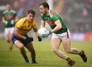 25 May 2019; Darren Coen of Mayo and Sean Mullooly of Roscommon during the Connacht GAA Football Senior Championship Semi-Final match between Mayo and Roscommon at Elverys MacHale Park in Castlebar, Mayo. Photo by Stephen McCarthy/Sportsfile