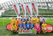 29 May 2019; The SPAR FAI Primary School 5s National Finals took place in AVIVA Stadium on Wednesday, May 29, where former Republic of Ireland International Keith Andrews and current Republic of Ireland women's footballer, Megan Campbell were in attendance supporting as girls and boys from 13 counties battled it out for national honours. The 2019 SPAR FAI Primary School 5s Programme was the biggest yet with a record 37,448 participants from 1,696 schools taking part in county, regional and provincial blitzes nationwide. Pictured are players and coaches from the winning girls team Mucklagh NS, Co Offaly and boys team St. Oran's NS, Cockhill,  Co Donegal with Spar Representatives Carl and Colm McDaid. Photo by David Fitzgerald/Sportsfile