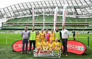 29 May 2019; The SPAR FAI Primary School 5s National Finals took place in AVIVA Stadium on Wednesday, May 29, where former Republic of Ireland International Keith Andrews and current Republic of Ireland women's footballer, Megan Campbell were in attendance supporting as girls and boys from 13 counties battled it out for national honours. The 2019 SPAR FAI Primary School 5s Programme was the biggest yet with a record 37,448 participants from 1,696 schools taking part in county, regional and provincial blitzes nationwide. Pictured are players and coaches from Glenswilly NS, Co Donegal with Spar Representatives Carl and Colm McDaid. Photo by David Fitzgerald/Sportsfile