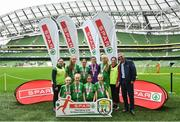 29 May 2019; The SPAR FAI Primary School 5s National Finals took place in AVIVA Stadium on Wednesday, May 29, where former Republic of Ireland International Keith Andrews and current Republic of Ireland women's footballer, Megan Campbell were in attendance supporting as girls and boys from 13 counties battled it out for national honours. The 2019 SPAR FAI Primary School 5s Programme was the biggest yet with a record 37,448 participants from 1,696 schools taking part in county, regional and provincial blitzes nationwide. Pictured are players and coaches from Schoil Mhuire Clarinbridge NS, Co Galway with Spar Representative John Caldwell. Photo by David Fitzgerald/Sportsfile