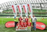 29 May 2019; The SPAR FAI Primary School 5s National Finals took place in AVIVA Stadium on Wednesday, May 29, where former Republic of Ireland International Keith Andrews and current Republic of Ireland women's footballer, Megan Campbell were in attendance supporting as girls and boys from 13 counties battled it out for national honours. The 2019 SPAR FAI Primary School 5s Programme was the biggest yet with a record 37,448 participants from 1,696 schools taking part in county, regional and provincial blitzes nationwide. Pictured are players and coaches from Faha NS, Kerry with Spar Representative Norman Foley. Photo by David Fitzgerald/Sportsfile