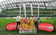 29 May 2019; The SPAR FAI Primary School 5s National Finals took place in AVIVA Stadium on Wednesday, May 29, where former Republic of Ireland International Keith Andrews and current Republic of Ireland women's footballer, Megan Campbell were in attendance supporting as girls and boys from 13 counties battled it out for national honours. The 2019 SPAR FAI Primary School 5s Programme was the biggest yet with a record 37,448 participants from 1,696 schools taking part in county, regional and provincial blitzes nationwide. Pictured are players and coaches from St. Oran's NS, Cockhill, Donegal with Spar Representatives Carl and Colm McDaid. Photo by David Fitzgerald/Sportsfile