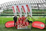 29 May 2019; The SPAR FAI Primary School 5s National Finals took place in AVIVA Stadium on Wednesday, May 29, where former Republic of Ireland International Keith Andrews and current Republic of Ireland women's footballer, Megan Campbell were in attendance supporting as girls and boys from 13 counties battled it out for national honours. The 2019 SPAR FAI Primary School 5s Programme was the biggest yet with a record 37,448 participants from 1,696 schools taking part in county, regional and provincial blitzes nationwide. Pictured are players and coaches from Lisnagry NS, Co Limerick with Spar Representative Hugh Sweeney. Photo by David Fitzgerald/Sportsfile