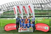 29 May 2019; The SPAR FAI Primary School 5s National Finals took place in AVIVA Stadium on Wednesday, May 29, where former Republic of Ireland International Keith Andrews and current Republic of Ireland women's footballer, Megan Campbell were in attendance supporting as girls and boys from 13 counties battled it out for national honours. The 2019 SPAR FAI Primary School 5s Programme was the biggest yet with a record 37,448 participants from 1,696 schools taking part in county, regional and provincial blitzes nationwide. Pictured are players and coaches from Gaelscoil Chill Mhantain, Co Wicklow with Spar Representative Louis Byrne. Photo by David Fitzgerald/Sportsfile