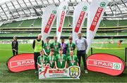 29 May 2019; The SPAR FAI Primary School 5s National Finals took place in AVIVA Stadium on Wednesday, May 29, where former Republic of Ireland International Keith Andrews and current Republic of Ireland women's footballer, Megan Campbell were in attendance supporting as girls and boys from 13 counties battled it out for national honours. The 2019 SPAR FAI Primary School 5s Programme was the biggest yet with a record 37,448 participants from 1,696 schools taking part in county, regional and provincial blitzes nationwide. Pictured are players and coaches from Cregmore NS, Claregalway, Co Galway with Spar Representative Tom Meehan. Photo by David Fitzgerald/Sportsfile