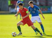 13 May 2019; Eduardo Quaresma of Portugal and Nicolò Cudrig of Italy during the 2019 UEFA European Under-17 Championships quarter-final match between Italy and Portugal at Tolka Park in Dublin. Photo by Stephen McCarthy/Sportsfile