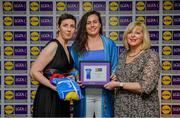 31 May 2019; The 2019 Teams of the Lidl Ladies National Football League awards were presented at Croke Park on Friday, May 31. The best players from the four divisions in the Lidl National Football Leagues were selected by the LGFA's All Star committee. Hannah Looney of Cork is pictured receiving her Division 1 award from Marie Hickey, Ladies Gaelic Football Association President, and Sian Gray, Head of Marketing, Lidl Ireland. Photo by David Fitzgerald/Sportsfile