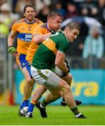 1 June 2019; Stephen O'Brien of Kerry in action against Sean Collins of Clare during the Munster GAA Football Senior Championship semi-final match between Clare and Kerry at Cusack Park in Ennis, Co Clare. Photo by Diarmuid Greene/Sportsfile