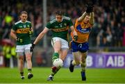 1 June 2019; David Moran of Kerry in action against Sean O'Donoghue of Clare during the Munster GAA Football Senior Championship semi-final match between Clare and Kerry at Cusack Park in Ennis, Co Clare. Photo by Diarmuid Greene/Sportsfile
