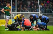 1 June 2019; Sean O'Shea of Kerry and Kevin Harnett of Clare receive medical attention after they collided during the Munster GAA Football Senior Championship semi-final match between Clare and Kerry at Cusack Park in Ennis, Co Clare. Photo by Diarmuid Greene/Sportsfile